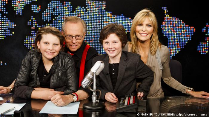 Larry King alongside wife Shawn and sons Chance and Cannon