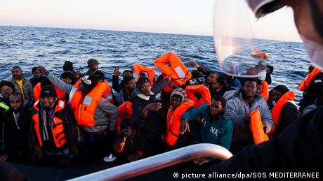 A small boat full of migrants in the Mediterranean Sea