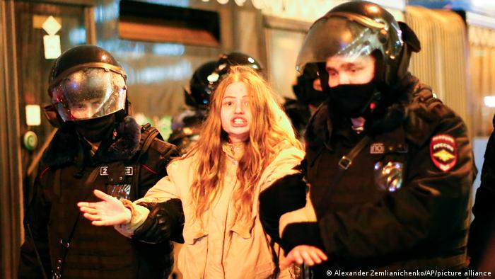 Police detain a woman during a protest against the jailing of opposition leader Alexei Navalny in Moscow, Russia