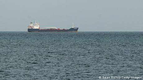 a picture of a container ship on the horizon