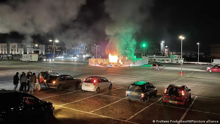 The portable test center on fire in a car park
