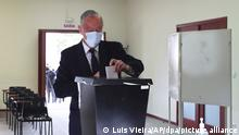 President Marcelo Rebelo de Sousa casts his ballot during presidential elections in Portugal