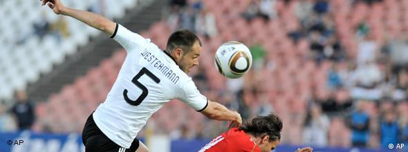 Heiko Westermann of Germany, left, and Szabolcs Huszti of Hungary, right, fight for the ball during a friendly soccer match between Hungary and Germany in Budapest, Hungary, Saturday, May 29, 2010.