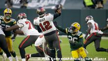 Green Bay Packers' Darnell Savage (26) puts pressure on Tampa Bay Buccaneers quarterback Tom Brady as he throws a pass intercepted by Green Bay Packers' Jaire Alexander during the second half of the NFC championship NFL football game in Green Bay, Wis., Sunday, Jan. 24, 2021. (AP Photo/Mike Roemer)