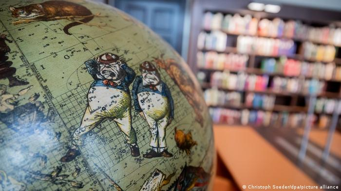 A globe with Alice in Wonderland motis in one of the reading rooms