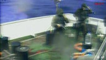 A video still purporting to show Israeli soldiers aboard a vessel surrounding a Turkish ship