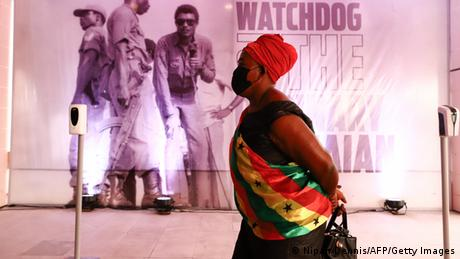 A woman waits in line during the lay in state of former Ghana President Jerry Rawlings in Accra