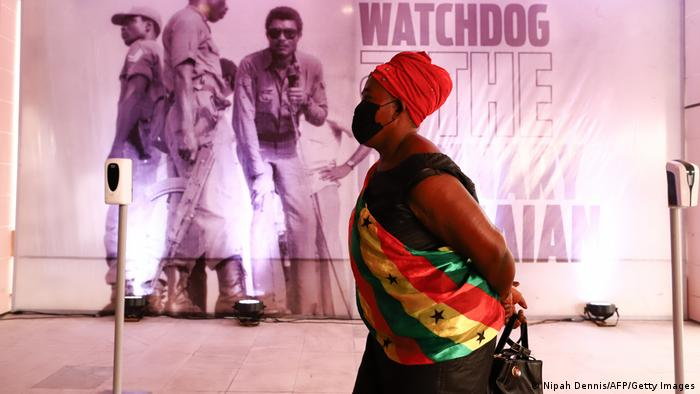 An elderly woman waits in a queue during the lay in state of former Ghana President Jerry John Rawlings in Accra