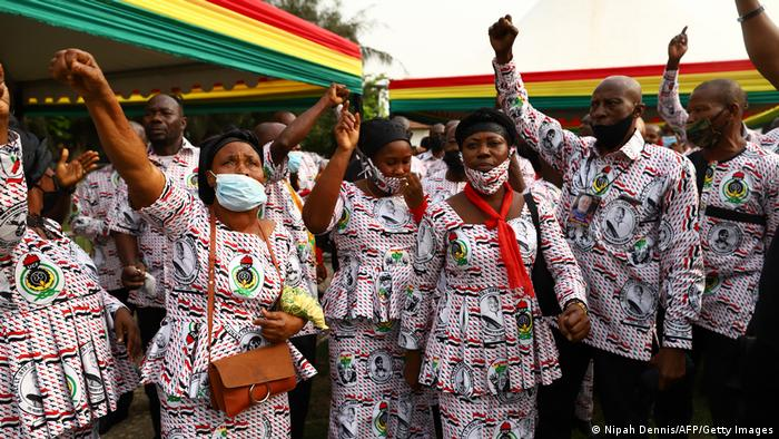 Staff of the former Ghana President Jerry John Rawlings sing at the lay in state in Accra, Ghana