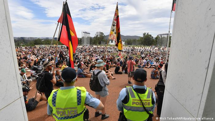 Police observe a protest in Sydney on January 26, 2021.