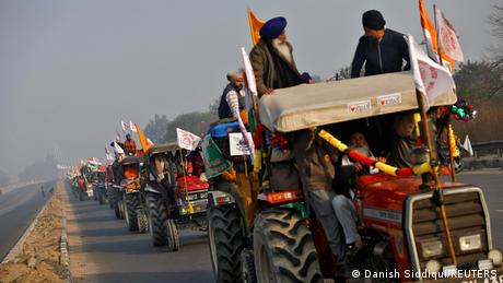 Farmers take part in a tractor rally to protest against farm laws