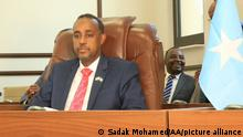 23.09.2020 MOGADISHU, SOMALIA - SEPTEMBER 23: Newly appointed Mohamed Hussein Roble (2nd L) endorsed by all 215 members of parliament during a vote of confidence session attended by Somalian President Mohamed Abdullahi Farmaajo (not seen) in the capital Mogadishu, Somalia on September 23, 2020. Somali lawmakers on Wednesday approved Mohamed Hussein Roble as the country's new prime minister in a landslide vote. Sadak Mohamed / Anadolu Agency