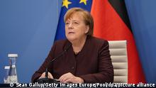 Angela Merkel address the Davos forum by videolink