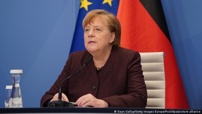 Angela Merkel address the Davos forum by videolink
