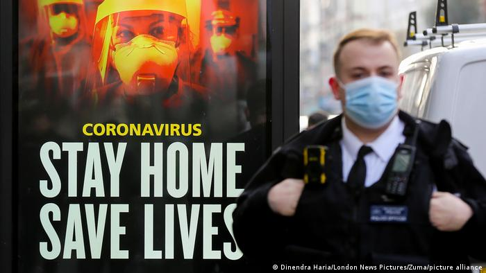 Sign reading Stay Home, Save Lives campaign in the UK