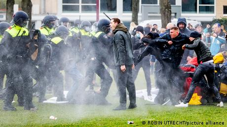 Police face off with shouting protesters in Amsterdam