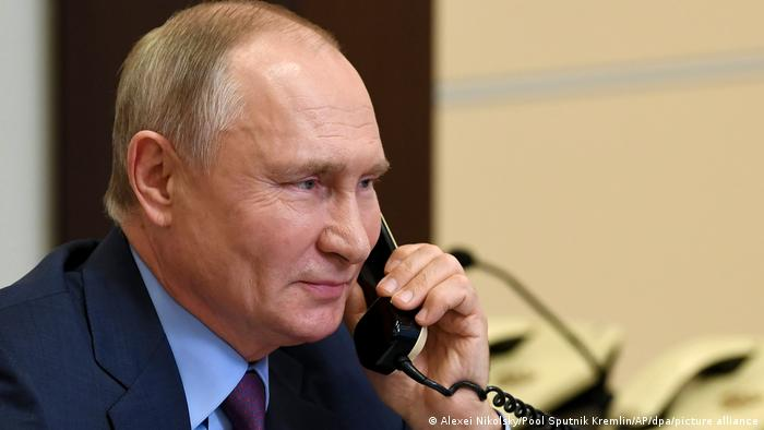 Vladimir Putin on the telephone