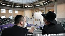 Two rabbis sit in the Bundestag ahead of the memorial service