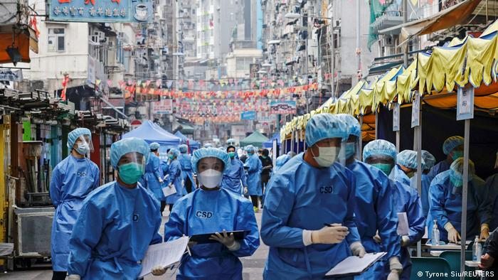 Health workers are seen in protective gear inside a locked down portion of the Jordan residential area in Hong Kong