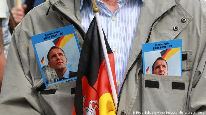 Höcke supporter's jacked decorated with Höcke photos and German flag