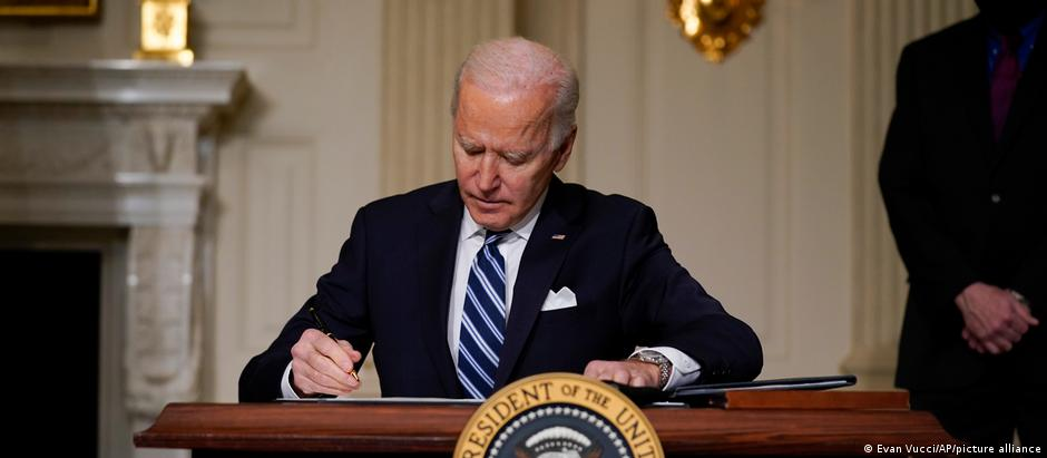 Joe Biden signing an executive order on climate change