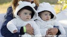 August 4, 2019, Kiev, Ukraine: Twin children attend an event dedicated to the International Day of Twins in Kiev..Representatives of the National Register of Records set the new country's record at 67 baby carriages (strollers) at one location during the event. The event marked the World Twins Day, celebrated in the world on the first Sunday of August. Goal of the event is to promote family and healthy lifestyles, attract attention to the issue of maintaining pregnancy and reducing the risk of premature birth, in particular, in the birth of twins. (Credit Image: © Pavlo Gonchar/SOPA Images via ZUMA Wire