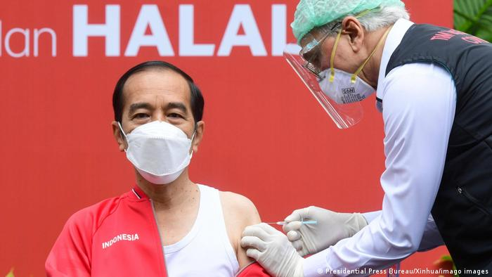 Indonesian President Joko Widodo receives his shot of Sinovac Biotech