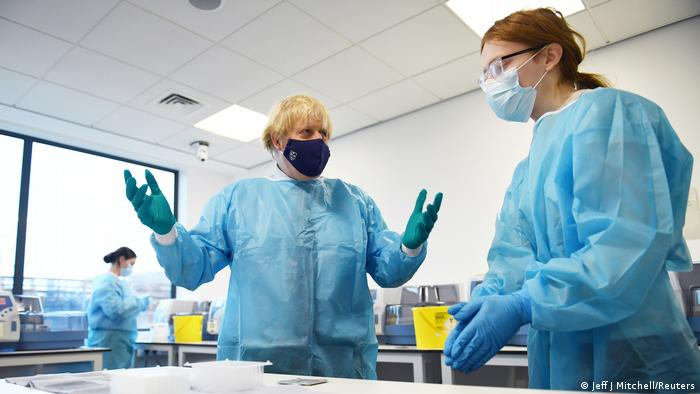 British Prime Minister Boris Johnson is shown the Lighthouse Laboratory used for processing PCR samples, during a visit to the Queen Elizabeth University Hospital campus in Glasgow
