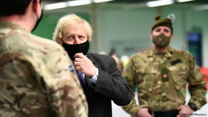 British Prime Minister Boris Johnson meets troops as they set up a vaccination centre in the Castlemilk district of Glasgow, Scotland.