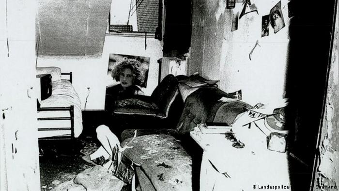 Black-and-white photo of the asylum-seekers' accommodation after the fire