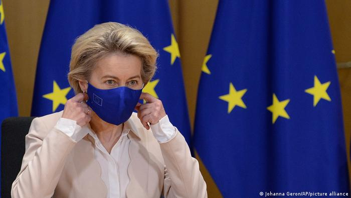 European Commission President Ursula von der Leyen takes off her mask
