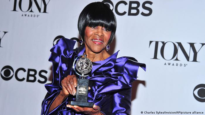 Cicely Tyson on stage holding her Tony Award