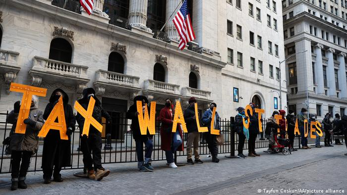 A group of demonstrators are gathered by the New York Stock Exchange building to protest Robinhood and bring their voices to Wall Street trades amid GameStop stock chaos in New York City