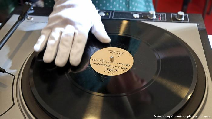 A white-gloved hand spins a record with Ebert's voice recorded on it