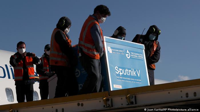 Airport workers unload a shipment of the Sputnik V vaccine at Bolivia's international airport