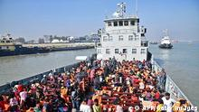 TOPSHOT - Rohingya refugees are seen on a Bangladesh's Navy ship as they are being relocated to Bhashan Char Island in the Bay of Bengal, in Chittagong on January 29, 2021. (Photo by - / AFP) (Photo by -/AFP via Getty Images)
