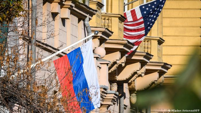 US and Russian flags hang outside the US Embassy building in Moscow
