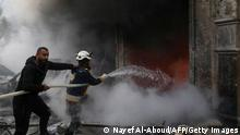 EDITORS NOTE: Graphic content / Rescue workers extinguish a fire cause by an explosion in the town of Azaz in the rebel-controlled northern countryside of Syria's Aleppo province,on January 31, 2021. - A car bomb killed at least four people, including three civilians, in the Turkish-held northern town of Azaz in war-torn Syria today, a war monitor said. The attack, which occurred near a cultural centre, also wounded more than 22 others, the Britain-based Syrian Observatory for Human Rights said. (Photo by Nayef Al-ABOUD / AFP) (Photo by NAYEF AL-ABOUD/AFP via Getty Images)