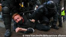 ST PETERSBURG, RUSSIA - JANUARY 31, 2021: Riot police officers detain a demonstrator during an unauthorised protest in support of the detained opposition activist Alexei Navalny. Navalny, who had been handed a suspended sentence in the Yves Rocher case in 2014, was detained at Sheremetyevo Airport near Moscow on 17 January 2021 for violating probation conditions. A court ruled that Navalny be put into custody until 15 February 2021. Peter Kovalev/TASS