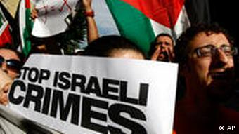 Pro-Palestinian activists hold banners as they approach the Israel embassy in Rome in June