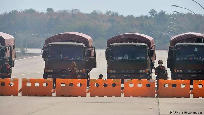 Military trucks block the entrance to Myanmar's parliament