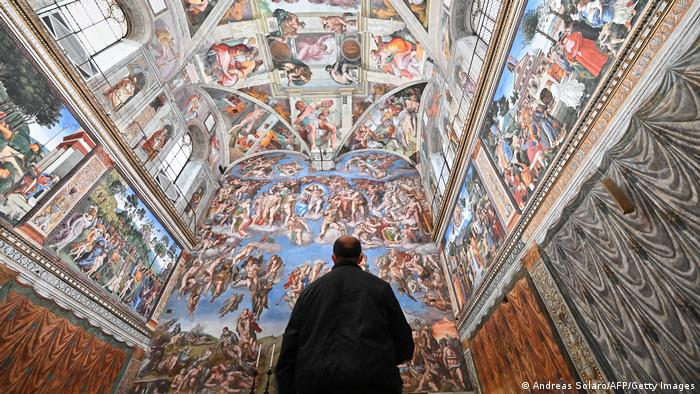 A man visits the Sistine Chapel on the reopening day of the Vatican museum