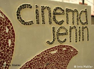 Sign outside the newly restored cinema in Jenin