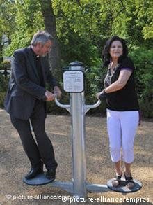 Reverend Rob Gillion, area Dean of Chelsea, joins Madeline Elsdon, of the Knightsbridge Association, for a keep fit session at London's first pensioner's playground in Hyde Park