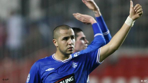 Rangers' Madjid Bougherra reacts at the end of the match during their soccer match of the UEFA Champions League against Sevilla at the Ramon Sanchez Pizjuan stadium in Seville on Wednesday, Dec. 9, 2009