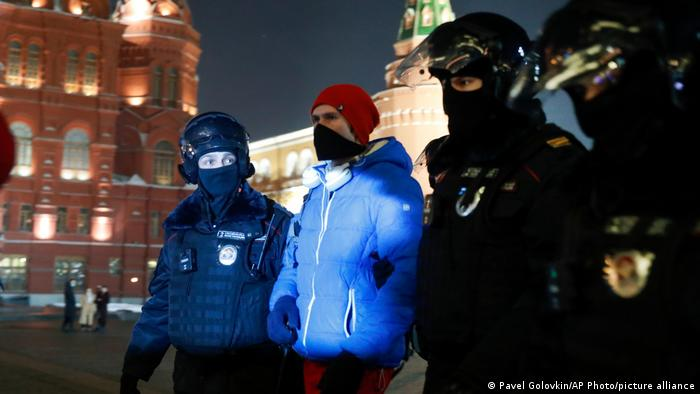 Policemen detain Navalny supporter at the Red Square in Moscow, Russia