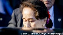 Myanmar's State Counsellor Aung San Suu Kyi leaves the Peace palace in The Hague, on December 12, 2019 on the the last day of a three-day hearing on the Rohingya genocide case before the UN International Court of Justice. - The Gambia hit out Thursday at Aung San Suu Kyi's silence over the plight of Rohingya Muslims after the Nobel peace laureate defended Myanmar against genocide charges at the UN's top court. (Photo by Sem VAN DER WAL / ANP / AFP) / Netherlands OUT (Photo by SEM VAN DER WAL/ANP/AFP via Getty Images)