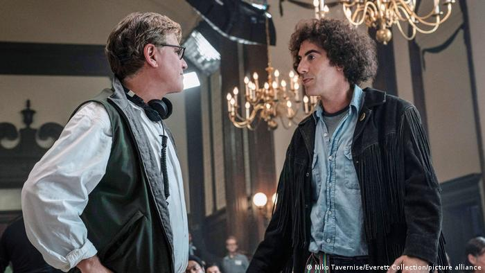 Author and director Aaron Sorkin on the film set with Sacha Baron Cohen