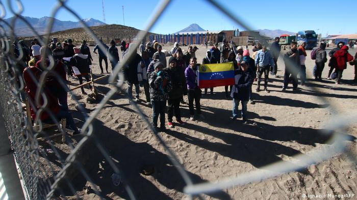 Migrantes venezolanos en Colchane, en la frontera de Chile con Bolivia.