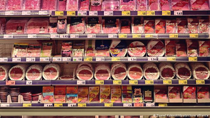 Shelves in a supermarket stacked with meat cold cuts